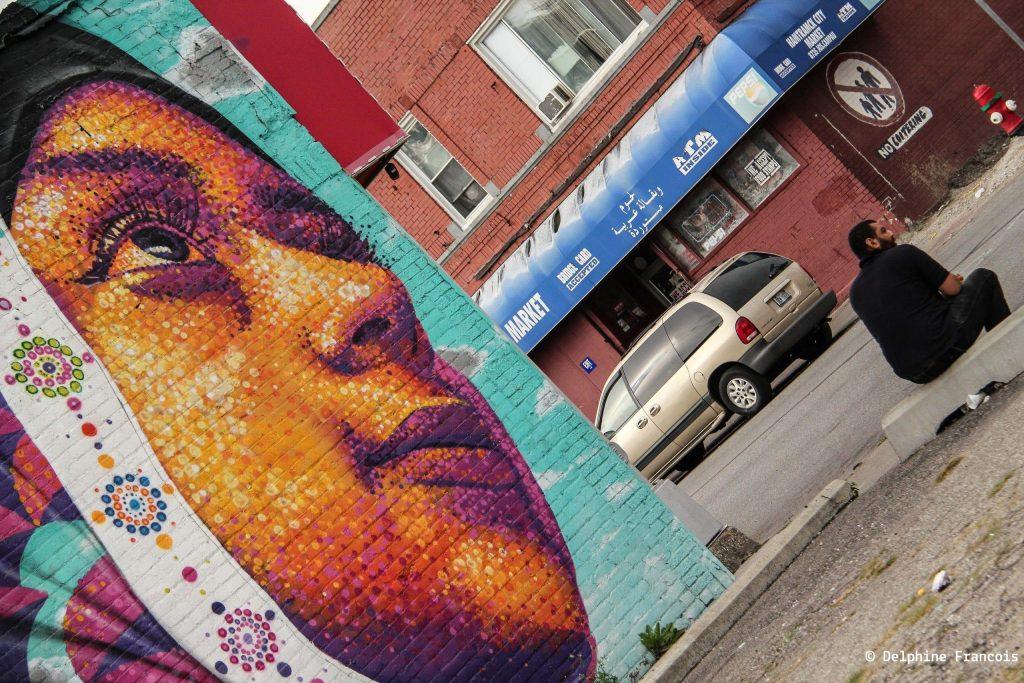 graffiti représentant le visage d'une femme voilée